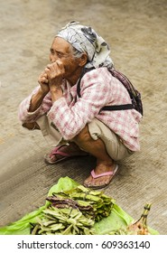 Banaue,Philippines-October 08,2016: Grandmother sells her produce from the orchard in local market on October 08, Banaue,Philippines.