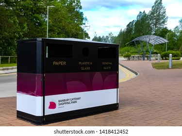 Banbury, Oxfordshire. England - June 5, 2019:  A rubbish bin with separate storage for paper, plastic, glass and general waste, an example of recycling for shoppers at Gateway Shopping Park.