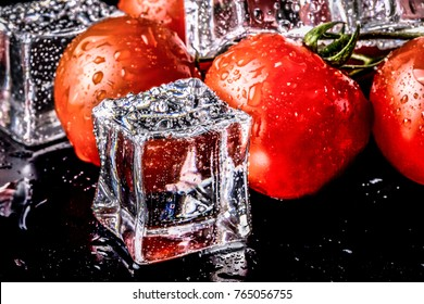 Banch of red cherry tomatos and ice cubes on black wet table. Selective focus. Toned.