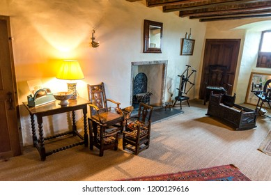 Banchory, Aberdeenshire / Scotland - September 2017: One of the rooms interior with an old baby cradle on a floor, Crathes Castle