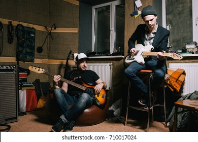 Band of adult guitarists rehearsing in studio. Grown-up musicians, creative hobby for hipsters, music repetition