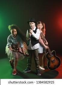 Band of little musicians on dark background