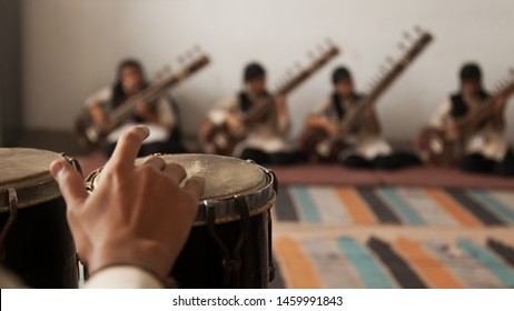 A Band of musicians playing Bongo and Sitar.