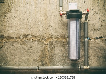 A band new water filter with plastic tubes in the basement