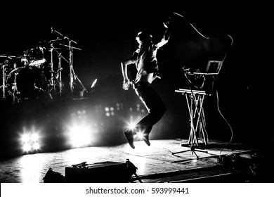 Band on stage. Vocalist silhouette
