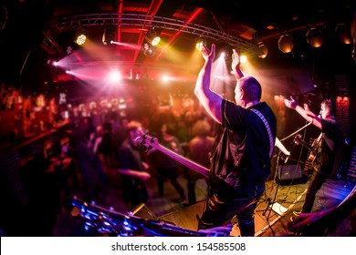 Band performs on stage, rock music concert