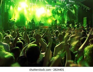 Band at a rock concert. Blur crowd