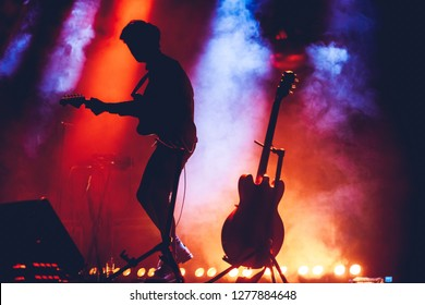Band Silhouette. Guitarist on stage. rock concert, bright light show
