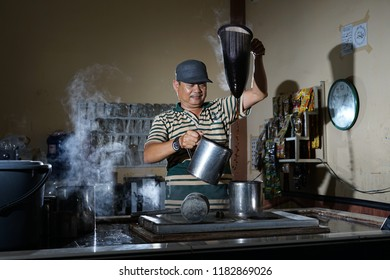 Banda Aceh, Aceh/INDONESIA, August 30, 2018: Traditional process of Aceh coffee making by Barista at Local Coffee Shop
