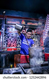 Banda Aceh, Indonesia - 26th February 2016: A Man Making A Glass of Warm Sanger Coffee (Aceh Traditional Cappucino)