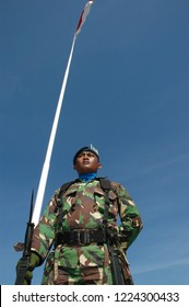 Banda Aceh, Indonesia - August 17, 2005: Indonesia Army Soldier with Indonesian Flag at Indonesian Independence day celebration at Blangpadang, banda aceh, Indonesia