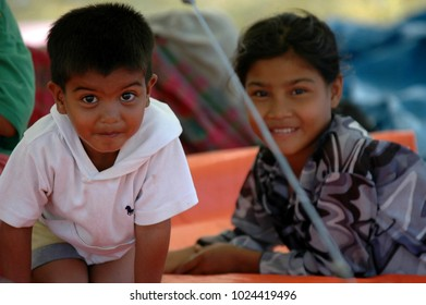 Banda Aceh, Aceh, Indonesia - December 30, 2004: Kids playing at shelter camps in Mata ie banda aceh, their villages and homes destroyed when Earthquake and Tsunami disaster in December 26 2004