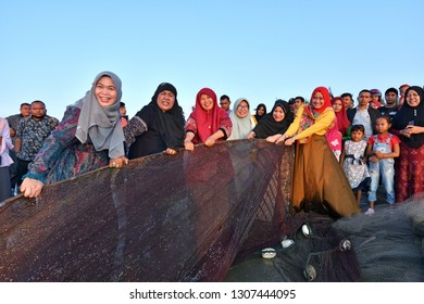 Banda Aceh, Indonesia - February 7, 2019: Darwati group mingled with local fishermen and the community tried to pull trawl. She is known as a public figure who is also the wife of Aceh Governor