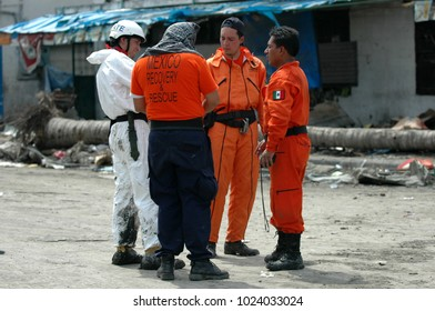 Banda Aceh, Aceh, Indonesia - January 5, 2005:Group of Mexican search and rescue teams search for survivors amongst the rubble of destroyed buildings and Houses