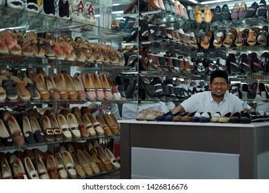 Banda Aceh, Indonesia - May 30, 2019: Vendor Selling Shoes and sandals at street footwear shop in Banda Aceh capital city