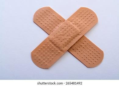 bandage cross on white background