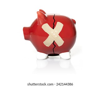 A bandage on a cracked red piggy bank representing troubled finances.
