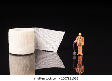 Bandage used for injuries during work, leisure time or in housework, isolated on glossy black background