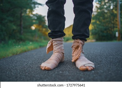 Bandage Wrapped Bare Feet On The Forest Road