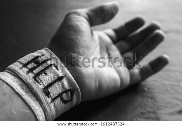 Bandaged forearm of a man on self-harming behavior in mental health disorders