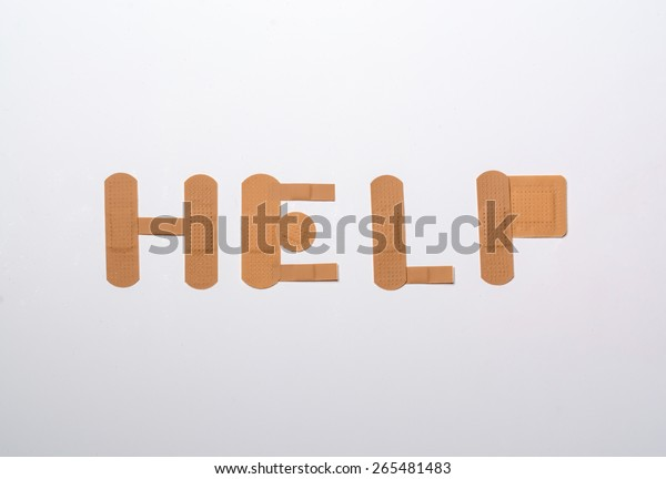 bandages forming the word help over white background