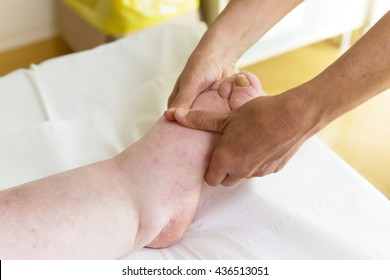 bandages legs and manual lymphatic drainage massage for a patient with swelling effect
