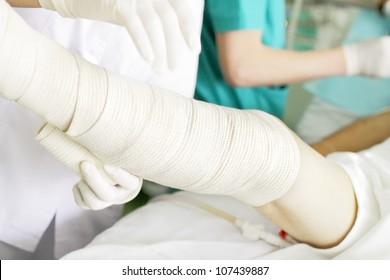 Bandaging of the legs with elastic bandage. photo.