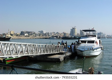 Bandar Abbas, Iran - March 18, 2010: People boarding a powerboat in Bandar Abbas port. Shuttle vessels commute passengers to and from nearby Hormoz and Qeshm islands.