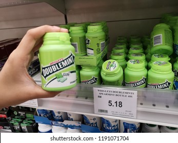 Bandar Bukit Tinggi , Malaysia - 17 September 2018 : Hand hold a bottle of WRIGLEY'S Doublemint Gum for sell in the supermarket.