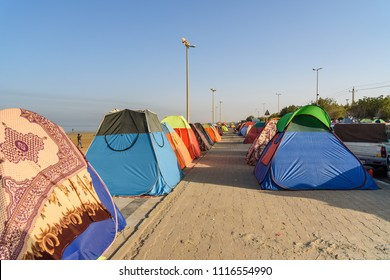 Bandar Ganaveh, Bushehr Province, Iran - March 27, 2018: Iranian travelers living in tents on the beach at Persian Gulf. A lot of Iranians traveling during the Persian New Year Norouz holidays