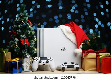 Bandar Lampung, INDONESIA - October 11, 2018 : Playstation 4 Pro 1TB White Glacier With Santa Hat Between Christmas Ornament Decoration
