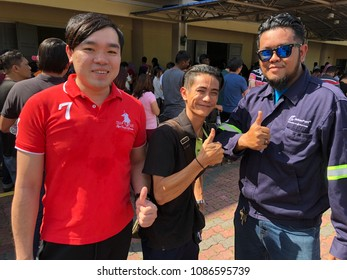 Bandar Seri Alam, Johor - 9 May 2018 : Three of voters que in line. Multi races in pooling for election day to choose the leader of country and state.