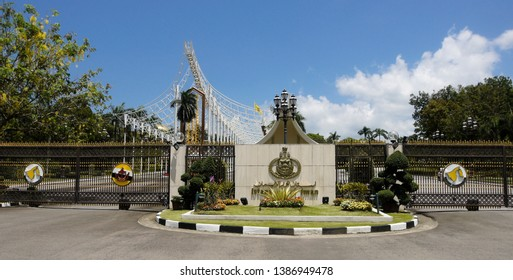 BANDAR SERI BEGAWAN, BRUNEI — APRIL 8, 2018. The royal crest and a gold-topped black iron fence mark the main entrance to Istana Nurul Iman (the Sultan's Palace) in the Sultanate of Brunei.