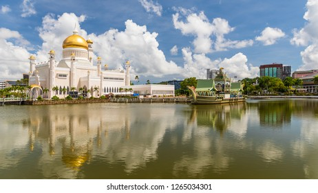 Bandar Seri Begawan, Brunei - December 2 2018: Masjid Omar 'Ali Saifuddien is a royal mosque, completed in 1958. The lagoon is adorned with a replica of a 16th-century Sultan Bolkiah Mahligai Barge