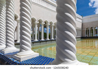 Bandar Seri Begawan, Brunei - December 2 2018: Ablution pool and colonnades of the Masjid Omar 'Ali Saifuddien is a royal mosque, completed in 1958.