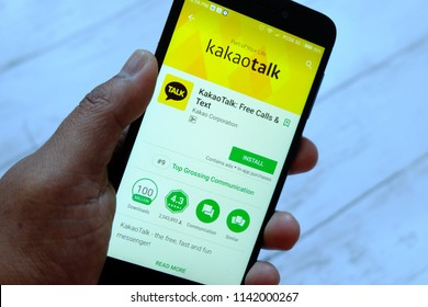 BANDAR SERI BEGAWAN,BRUNEI - JULY 25TH,2018 : A male hand holding smartphone with Kakaotalk apps on an android Google Play Store