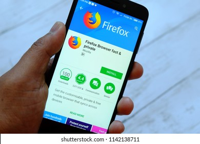 BANDAR SERI BEGAWAN,BRUNEI - JULY 25TH,2018 : A male hand holding smartphone with Mozilla Firefox app on an android Google Play Store