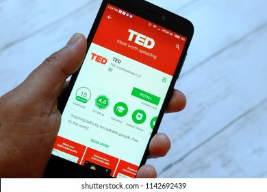 BANDAR SERI BEGAWAN,BRUNEI - JULY 25TH,2018 : A male hand holding smartphone with TED apps on an android Google Play Store