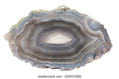 Banded Agate specimen found in Mexico, isolated on a white background. The layered structure is formed when a rock cavity or geode is filled with siliceous matter, layer by layer.