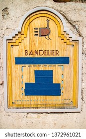 Bandelier National Monument, NM, USA - April 14, 2018: A Bandelier signage post along its stone wall
