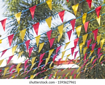 banderitas in front of our house during a fiesta