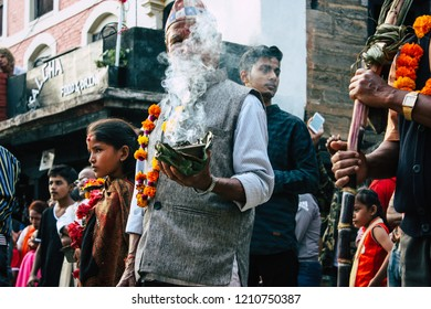 Bandipur Nepal October 16, 2018 View of unknowns people attending to an Hindu religious ceremony in the main street of Bandipur in the afternoon
