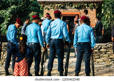 Bandipur Nepal October 17, 2018 View of unknown police officers and soldiers attending a religious ceremony front a Hindu temple for Dashain festival in the afternoon
