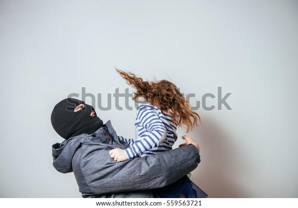 Bandit Balaclava Stolen Child Child Abduction Stock Photo