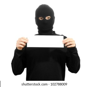 Bandit in black mask with blank card isolated on white