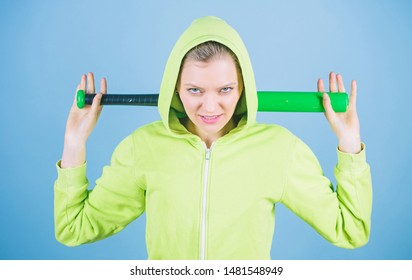 Bandit gang and conflict. aggressive woman with bat from bandit gang. woman workout with baseball bat. Fighting with aggression. Sport equipment. Athletic fitness. Street life. Sporty girl fighter.