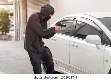 Bandit or Outlaw the Bad Guys wore black Robes with Guns hijacked the Stealth Car theft. Car Insurance concept