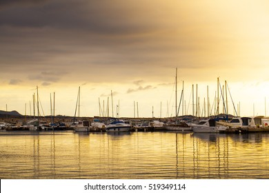 BANDOL, FRANCE - DECEMBER 24, 2014: Pier in the Mediterranean in the south of France at sunset time. Many yachts parked in the pier. Happiness, luxury and yachting concept. Post Card view.