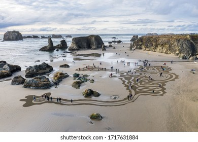 Bandon by the Sea, Oregon / USA - March 07 2020: People walking the labyrinth created by the team of Circles in the Sand in Bandon, Oregon