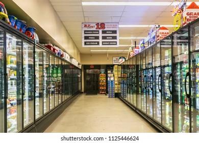 BANDON, OREGON - JUNE 8, 2018: Drinks and frozen food aisle in a McKay's market in Bandon, Oregon.